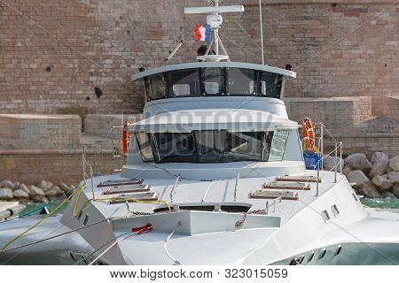 Fast Trimaran Boat Bridge Moored In Harbour