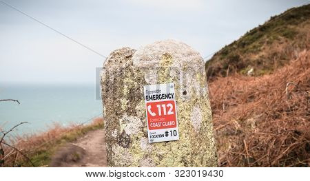 Emergency Call Sign In A Hiking Path In Howth, Ireland