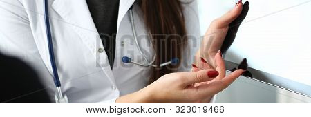 Female Doctor Hands Hold And Show Digital Tablet Pc To Patient Explaining Diagnosis. Physical Diseas