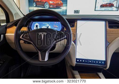 Seattle,wa/usa-9/15/29: A Tesla Car   Dashboard And Steering Wheel.  Tesla, Inc. Is An American Auto