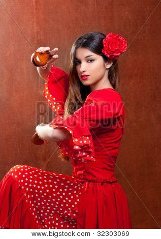 Castanets gypsy flamenco dancer Spain girl with red rose