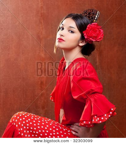 Flamenco dancer Spain woman gipsy with red rose and spanish peineta comb