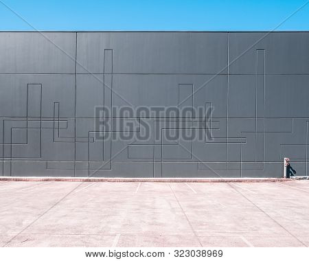 Unoccupied Parking Lot Next To Warehouse Wall With Copy Space - Industrial Architecture Minimalism