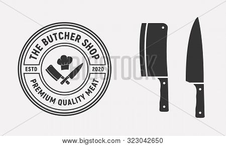 The Butcher Shop Vintage Logo Design With Meat Cleaver And Chef Knife Isolated On White Background.
