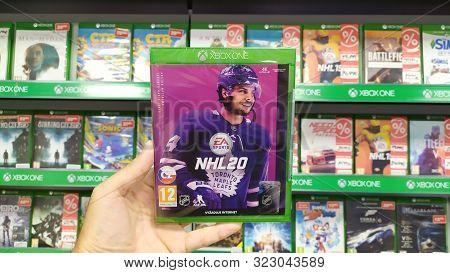 Bratislava, Slovakia, September 18, 2019: Man Holding Fifa 20 Videogame On Microsoft Xbox One Consol