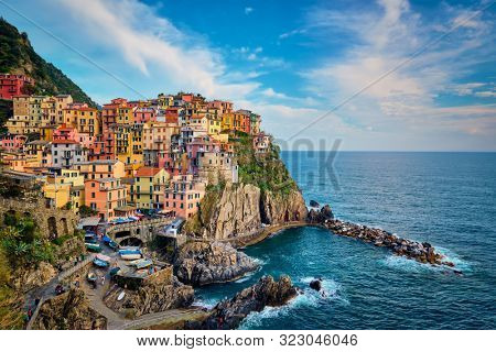 Manarola village popular european italian tourist destination in Cinque Terre National Park UNESCO World Heritage Site, Liguria, Italy on sunset