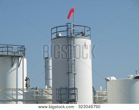 Manufacturing Tank Farm With Epa Windsock To Indicate Direction Of Wind Should Tank Gas Leak Into At