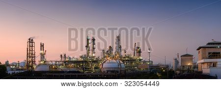 Panorama Of Oil And Gas Refinery Plant Or Petrochemical Industry On Sky Sunset Background, Manufactu