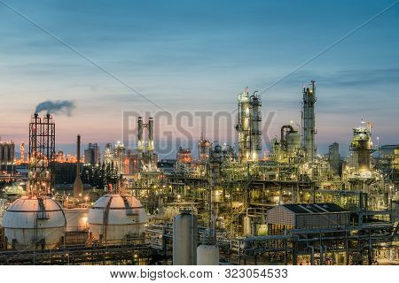 Oil And Gas Refinery Plant Or Petrochemical Industry On Sky Sunset Background, Gas Storage Sphere Ta