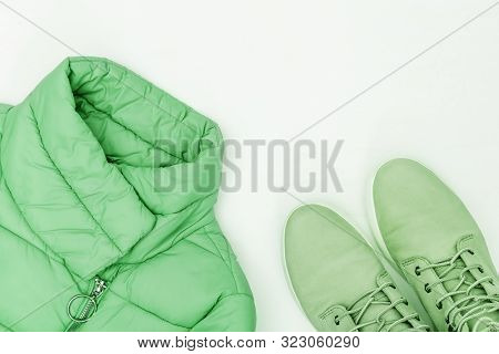 Bright Fashion Clothes Trend Color On White Background With Copy Space. Warm Down Jacket And Comfort