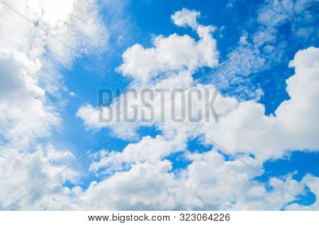 Blue sky background. Picturesque colorful clouds lit by sunlight. Vast sky landscape panoramic scene. Colorful sky view. Natural sky landscape, picturesque sky background