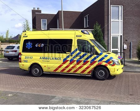 Almere, The Netherlands - September 13, 2017: Yellow Dutch Ambulance Parked On The Middle Of The Roa