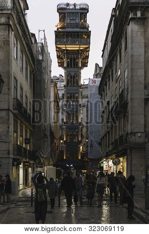 Lisbon, Portugal - August, 2019: Vertical Photo Of The Elevator Of Sant Justa Illuminated At Night,
