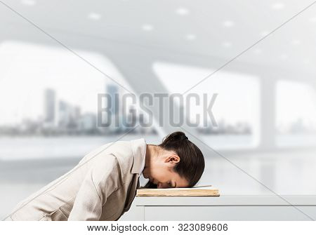 Exhausted Business Woman Face Down Sleeping On Desk With Notebook. Tired Corporate Employee Relaxing