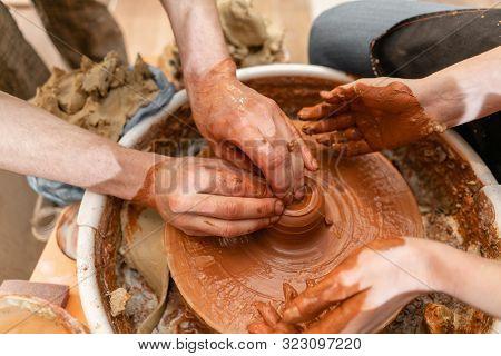 Master Ceramist Teaches Student.master Ceramist Teaches Student. Craftsman Hands Making Pottery Bowl