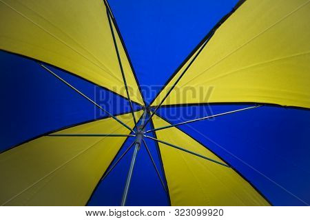 Underneath Inside A Blue And Yellow Umbrella