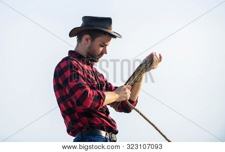 Ranch Worker. Eco Farm. Life At Ranch. Cowboy With Lasso Rope Sky Background. Farming Concept. Hands