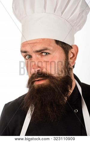 Male Chef. Professional Chef, Cook Or Baker. Food Concept. Bearded Chef In Uniform, Hat And Apron. C