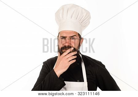 Male Cook In Chef Hat. Professional Cook Man. Chief Cook And Professional Culinary. Bearded Man In K