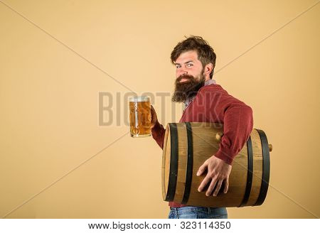 Beer Time. Bearded Man Hold Glass And Barrel With Craft Beer. Oktoberfest Festival. Attractive Beard
