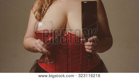 Gourmet And Pleasure. Wine In Front Of Big Breasts. Plus Size Model Hold Glass Of Wine. Girl Shows H