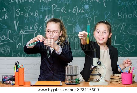 Gymnasium students with in depth study of natural sciences. School project investigation. School experiment. School for gifted children. Girls school uniform excited proving their hypothesis poster