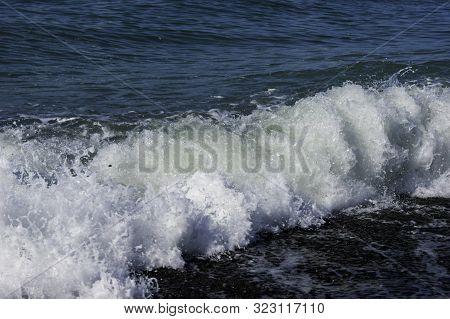 The Sea Worries Once - A Light Storm At Sea, A Wave Runs Onto A Pebble Beach, The Black Sea Coast