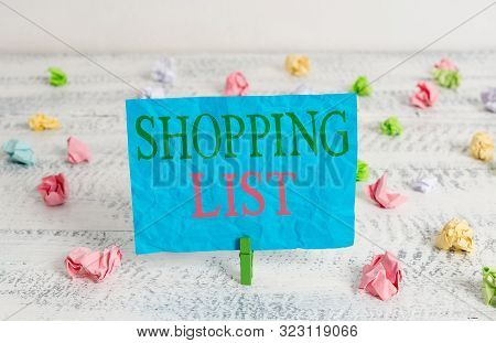 Word writing text Shopping List. Business concept for Discipline approach to shopping Basic Items to Buy Green clothespin white wood background colored paper reminder office supply. poster