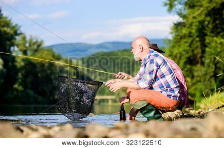 Active Lifestyle And Hobby. Fly Fish Hobby Of Men. Retirement Fishery. Two Male Friends Fishing Toge
