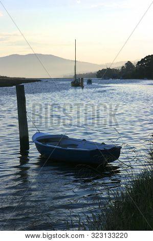 Wooden Row Boat Moored On The Huon River, Tasmania, Australia.