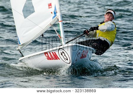 Lake Macquarie, Australia - April 16, 2013: Male High School Student Sailing Strait At The Camera Du
