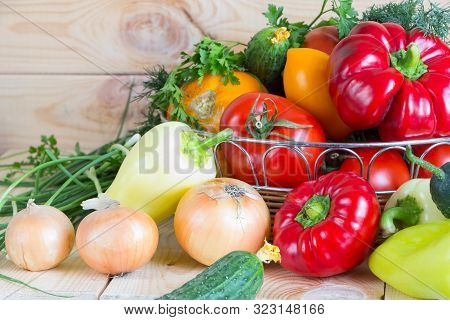 Natural Homegrown Food Concept. Assorted Fresh Vegetables From New Harvest Collected In A Wicker Bas