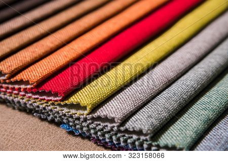Colorful And Bright Fabric Samples Of Furniture And Clothing Upholstery. Close-up Of A Palette Of Te