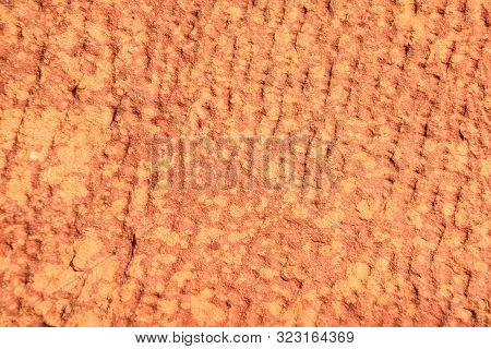 Red Laterite Stone Surface Texture Background.
