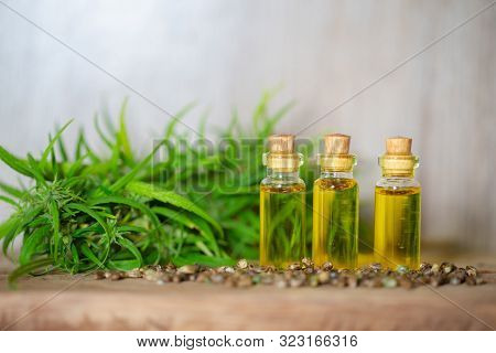 Cbd Oil Hemp Products, Medicinal Cannabis With Extract Oil In A Bottle On A Wooden Table. Medical Ca