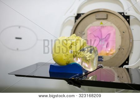 Human Tissue Mimicking Mannequin Head On A Medical Linear Accelerator (linac) Used For Radiation The