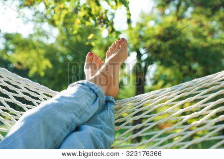 Young Woman Resting In Comfortable Hammock At Green Garden, Closeup