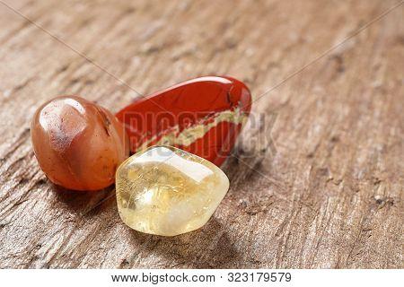 Beautiful Jade, Carnelian Agate And Citrine Quartz Gemstones On Textured Surface