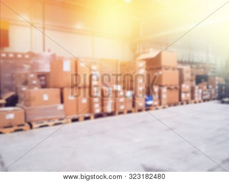 Warehouse Industrial And Logistics Companies. Blurry, Lots Of Boxes, Commercial Warehouse. Boxes And