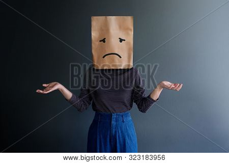Customer Experience Or Human Emotional Concept. Woman Covered Her Face By Paper Bag And Present Sadn