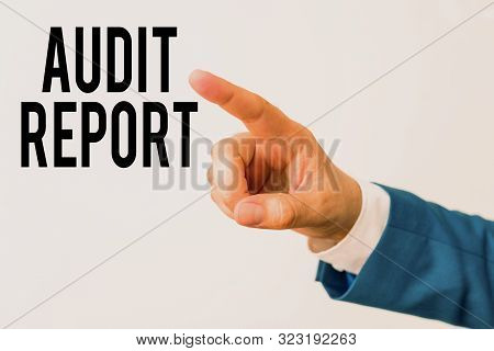 Writing note showing Audit Report. Business photo showcasing An appraisal of complete financial status of a business Assets Isolated hand pointing with finger. Business concept pointing finger. poster