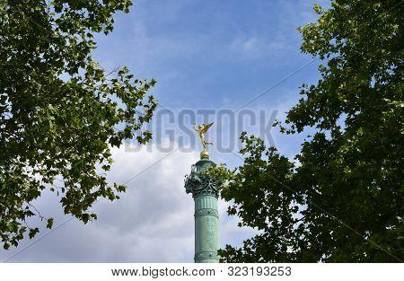 Colonne de Juillet at Place de la Bastille. Gilded statue (Genie de la Liberte) close-up. Paris, France.