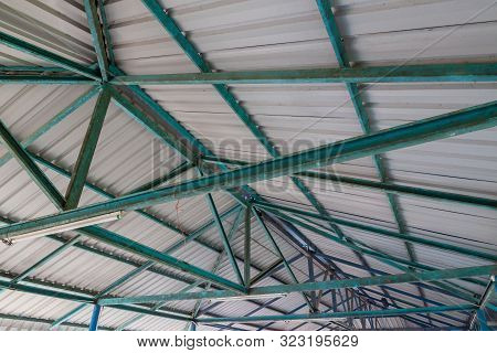 The Steel Structure Of The Roof. Structure Of Steel Roof Frame And Metal Sheet. Rusted Steel Structu