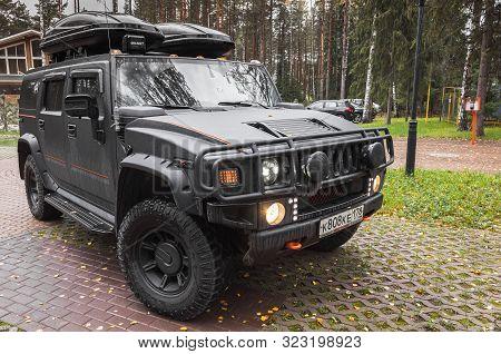 Saint-petersburg, Russia - October 8, 2017: Black Hummer H2 Car Stands On Rural Parking Lot In Russi
