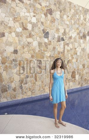 Woman standing next to hotel pool