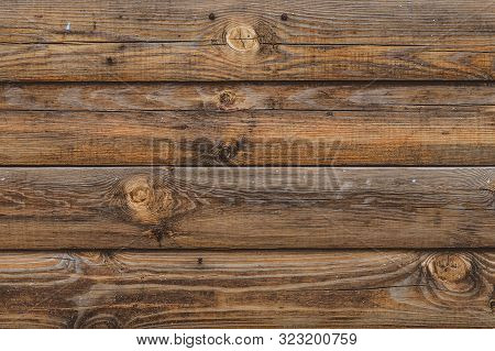 Dark Wooden Fence. Shabby Table, Dirty Pine Lumber. Old Wood Boards. Pattern, Surface Of Logs. Backg