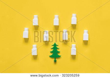 Creative Flat Lay Of Christmas Pine Tree And Snow In Plastic Building Blocks. Winter Season Top