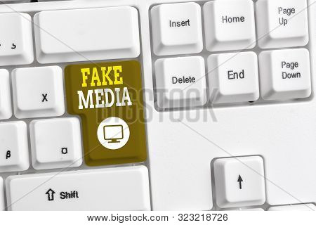 Text sign showing Fake Media. Conceptual photo An formation held by brodcasters which we cannot rely on White pc keyboard with empty note paper above white background key copy space. poster