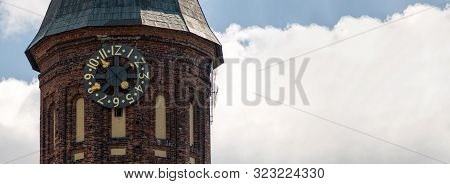 Clock Tower Of Konigsberg Cathedral, Copy Space. Brick Gothic-style Monument In Kaliningrad, Russia.