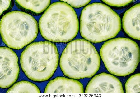 Cucumber-vegetable Background. Cucumbers In Cooking, Add To Salads, Soups, Snacks And Sauces, Salted